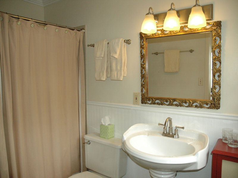 Square bathroom with tub/shower, sink, and toilet